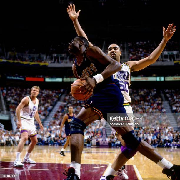 Dikembe Mutombo of the Denver Nuggets makes a move to the basket against Felton Spence of the Utah Jazz during Game One of the 1994 Western...