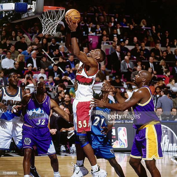 Dikembe Mutombo of the Eastern Conference AllStars attempts a layup against the Western Conference AllStars during the 1998 NBA AllStar game played...