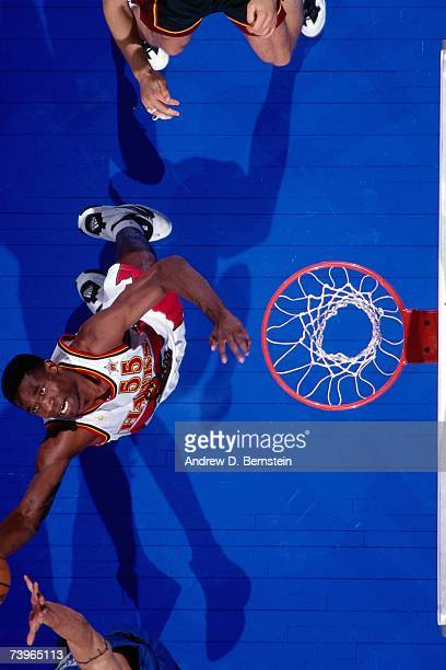 Dikembe Mutombo of the Eastern Conference grabs the rebound during the 1997 AllStar Game on February 9 1997 at Gund Arena in Cleveland Ohio NOTE TO...