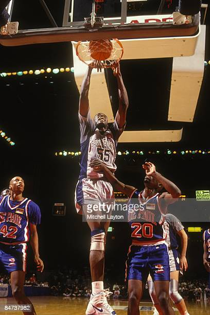 Dikembe Mutombo of the Georgetown Hoyas dunks during a college basketball game against the DePaul Blue Demons on December 15 1991 at Capitol Centre...