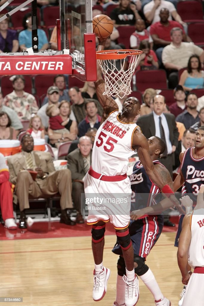 Dikembe Mutombo #55 of the Houston Rockets flies in for the dunk in front of Lorenzen Wright #42 of the Memphis Grizzlies on April 15, 2006 at the Toyota Center in Houston, Texas.