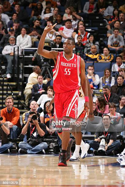 Dikembe Mutombo of the Houston Rockets makes his trademark finger wave after a blocked shot against the Golden State Warriors on April 10 2009 at...