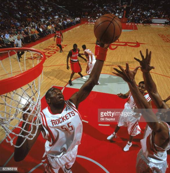 Houston Rockets News Today: Dikembe Mutombo Of The Houston Rockets Reaches For A