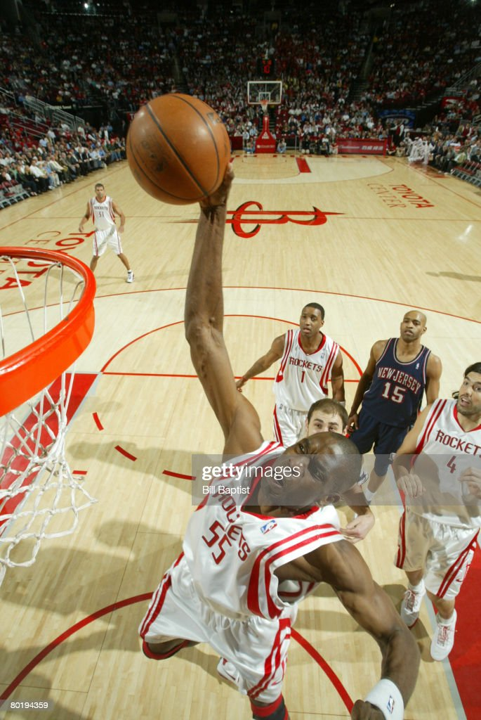 wholesale dealer 56a52 6c6e0 Dikembe Mutombo of the Houston Rockets shoots the ball on ...