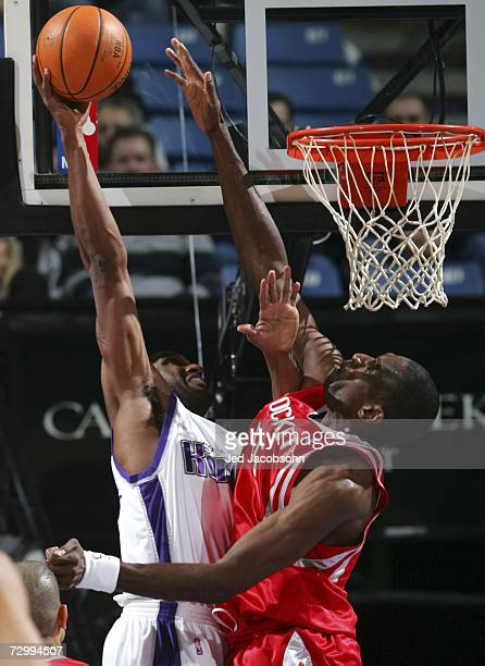 Dikembe Mutombo of the Houston Rockets tries to block a shot from Shareef AbdurRahim of the Sacramento Kings during an NBA game at Arco Arena January...