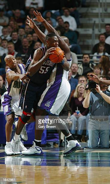 Dikembe Mutombo of the Milwaukee Bucks drives past Anthony Mason of the New Jersey Nets during the NBA game at the Bradley Center on November 6 2002...