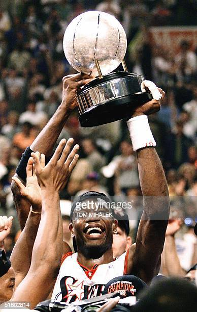 Dikembe Mutombo of the Philadelphia 76ers holds up the NBA Eastern Conference Trophy after the NBA Eastern Conference finals game seven 03 June 2001...