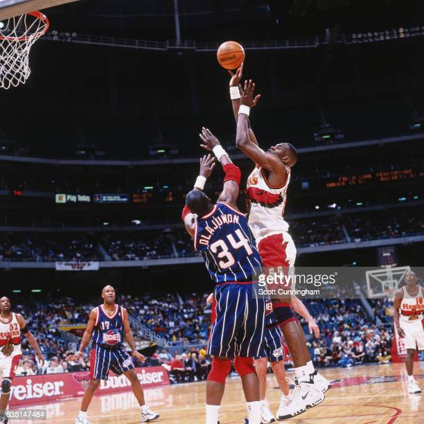f81eaf300 Dikembe Mutombo shoots against Hakeem Olajuwon of the Houston Rockets on  April 3 1998 at The