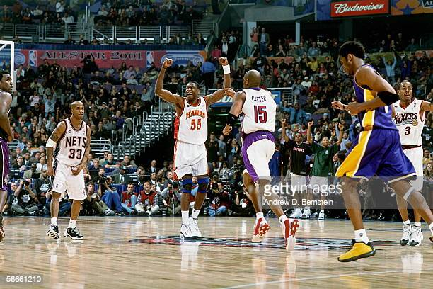 Dikembe Mutombo Stephon Marbury Vince Carter and Allen Iverson of the Eastern Conference AllStars celebrate during the 2002 NBA AllStar Game on...