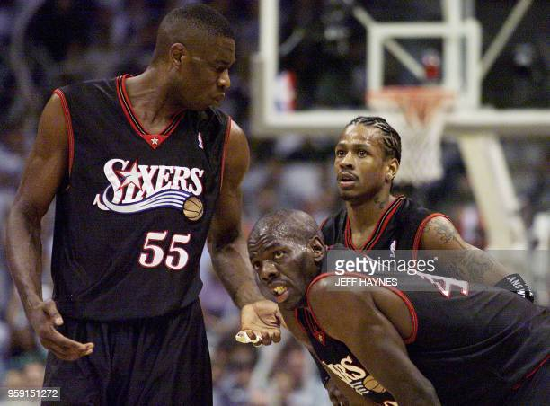 Dikembe Mutombo Tyrone Hill and Allen Iverson of the Philadelphia 76ers discuss their play during game six of their NBA Eastern Conference final 01...