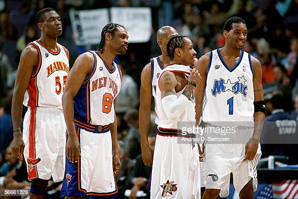 Dikembe Mutombo#55 Latrell Sprewell Glenn Robinson Allen Iverson and Tracy McGrady of the Eastern Conference AllStars talk during the 2002 NBA...