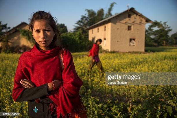 Dil Kumari Chaudhary stands outside of her parents house now age 21 was an exKamlari who was sold by her parents to a host family she was freed four...