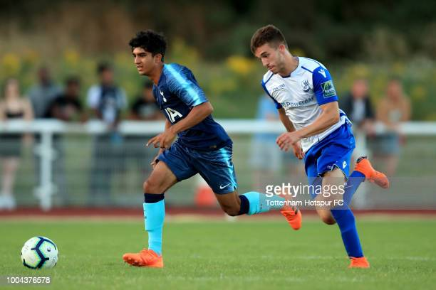 Dilan Markanday of Tottenham Hotspur in action with Billal Sayoud of Enfield Town during the PreSeason Friendly match between Enfield Town and...
