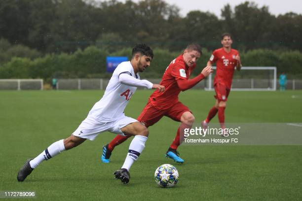 Dilan Markanday of Tottenham Hotspur in action with Dennis Waidner of Bayern Munich during the UEFA Youth League Group B match between Tottenham...