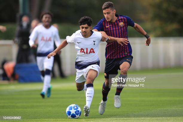 Dilan Markanday of Tottenham Hotspur in action with Nils Mortimer of Barcelona during the UEFA Youth League match between Tottenham Hotspur and...