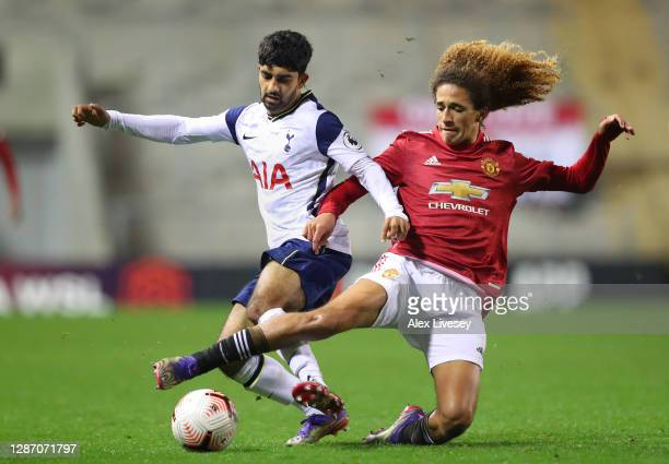Dilan Markanday of Tottenham Hotspur is tackled by Hannibal Mejbri of Manchester United during the Premier League 2 match between Manchester United...