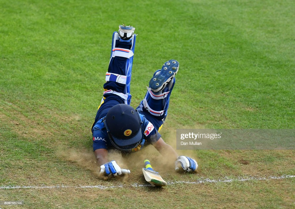 Dilani Manodara of Sri Lanka dives into her crease during the ICC Women's World Cup 2017 match between Sri Lanka and India at The 3aaa County Ground on July 5, 2017 in Derby, England.