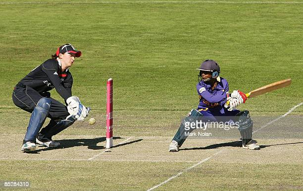 Dilani Manodara of Sri Lanka plays a cut shot as Sarah Taylor of England keeps wicket during the ICC Women's World Cup 2009 round one group stage...