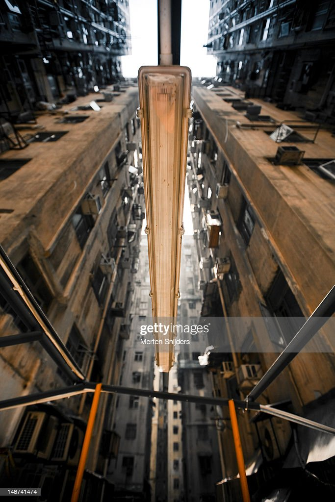 Dilapidated apartment blocks and light from below. : Stockfoto