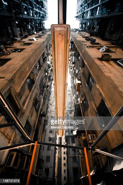 dilapidated apartment blocks and light from below. - merten snijders stockfoto's en -beelden