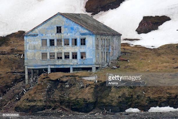 Dilapidated building of deserted Russian mining settlement in Svalbard between Longyearbyen and Barentsburg Isfjorden Spitsbergen Norway