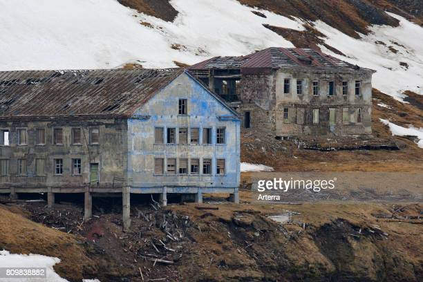 Dilapidated buildings of deserted Russian mining settlement in Svalbard between Longyearbyen and Barentsburg Isfjorden Spitsbergen Norway