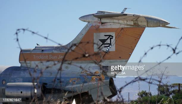 Dilapidated Cyprus Airways passenger plane is pictured behind barbed wire on the tarmac of the abandoned Nicosia airport in the UN-protected buffer...
