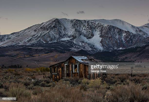A dilapidated house is viewed with a light dusting of new snow in the mountains on October 29 near Lee Vining California Despite four years of...