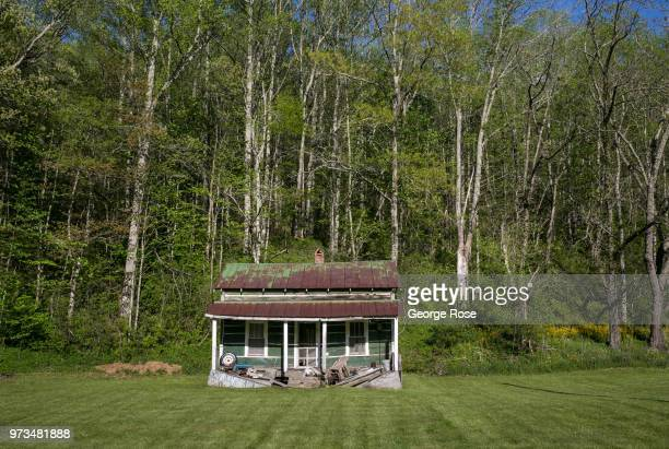 Dilapidated or abandoned homes dot the nearby hollows and wooded areas outside the downtown area on May 7 2018 in Asheville North Carolina Located in...