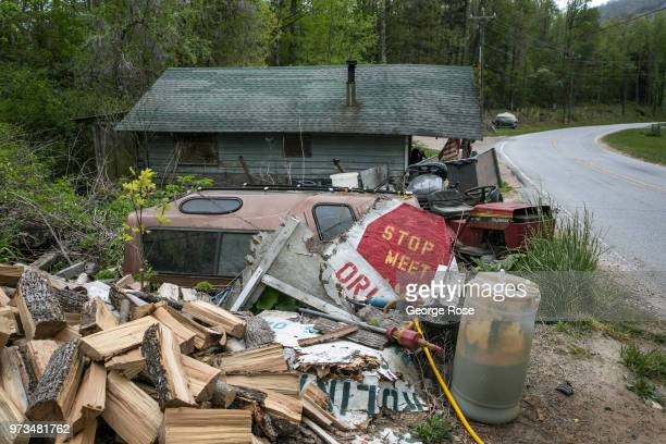 Dilapidated or rundown homes dot the nearby hollows and wooded backroads outside the downtown area on May 7 2018 near Asheville North Carolina...