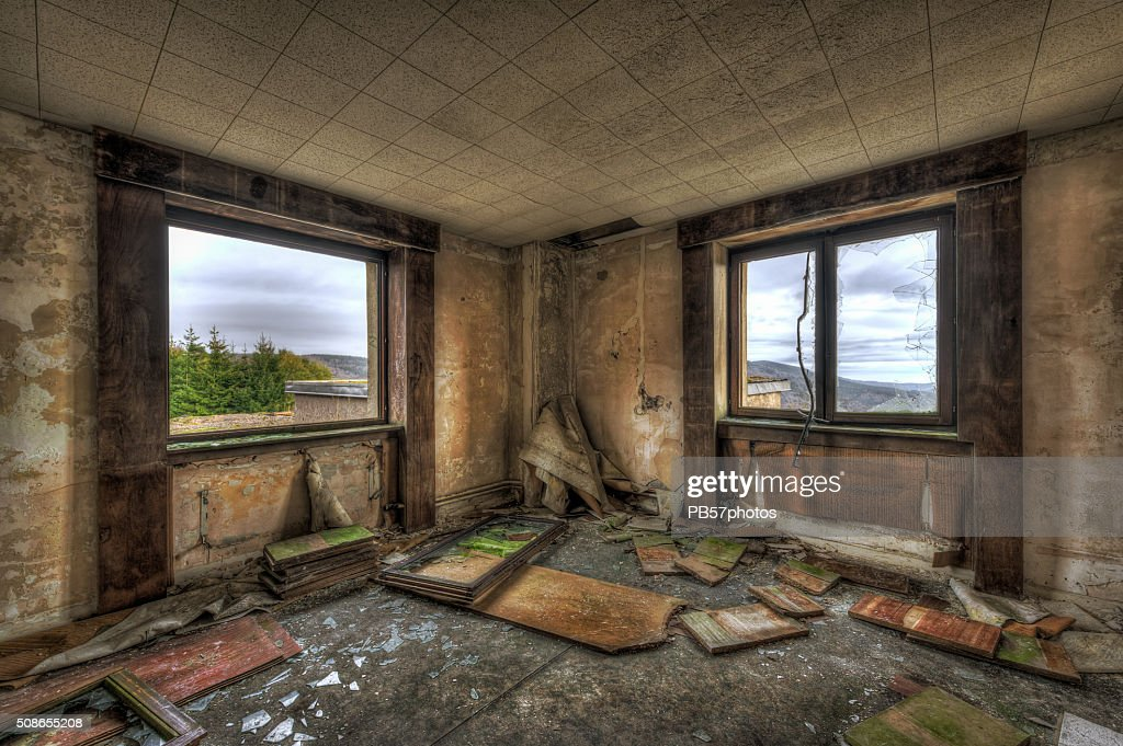 Dilapidated room in an abandoned building : Stock Photo
