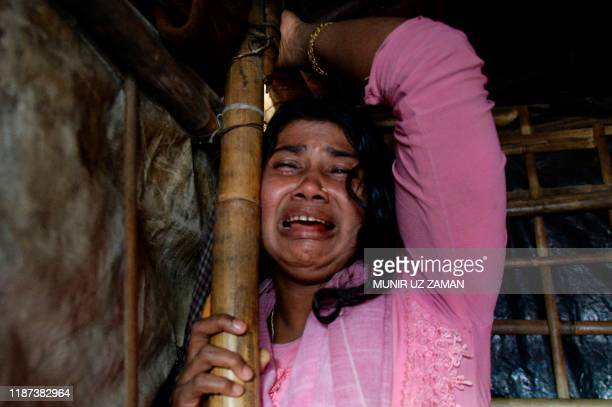 Dildar Begum, a Rohingya widow from Tula Toli village in Myanmar, breaks down in tears while describing the killings in her village that she claims...