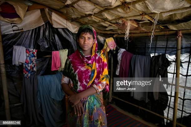 COX'S BAZAR BANGLADESH DECEMBER 03 Dildar Begum poses for a photo on December 3 2017 in Cox's Bazar Bangladesh She fled to Bangladesh shortly after...