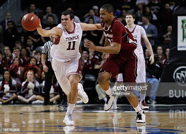 DiLeo of the Temple Owls and Terrell Vinson of the Massachusetts Minutemen pursue the loose ball during the Quarterfinals of the Atlantic 10...
