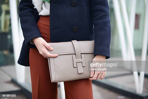 Diletta Bonaiuti poses wearing a Sandro coat vintage pants and Hermes clutch on January 17 2015 in Milan Italy