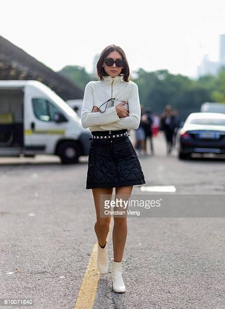 Diletta Bonaiuti wearing a black mini skirt and creme jacket outside Diesel during Milan Fashion Week Spring/Summer 2017 on September 23 2016 in...