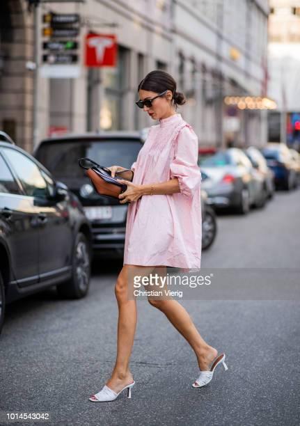 Diletta Bonaiuti wearing pink dress white mules seen outside Baum und Pferdgarten during the Copenhagen Fashion Week Spring/Summer 2019 on August 9...