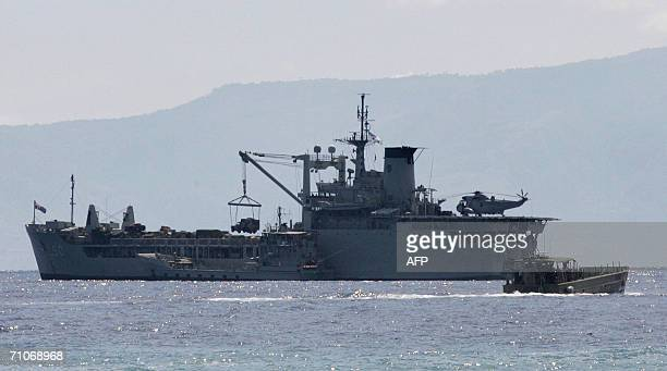 A army truck is unloaded onto a landing craft as hundreds of additional Australian troops arrive in Dili 28 May 2006 to boost an international...
