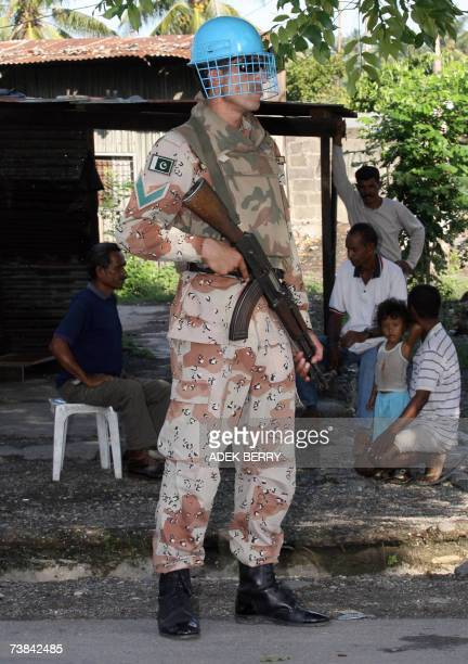 Pakistani soldier, part of the United Nations peacekeeping force, stands guard at the village of Bairopite, where conflict is common, during the...