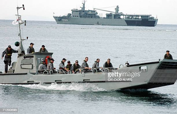 Australian soldiers patrol along the shore in Dili 14 June 2006 East Timor's President Xanana Gusmao distanced himself from efforts to oust his...