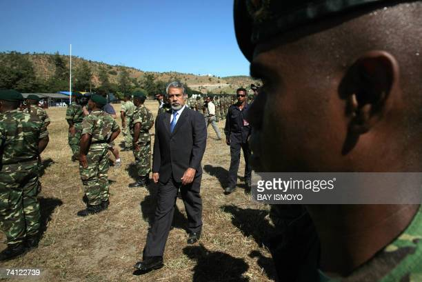 East Timorese acting President Xanana Gusmao inspects troops during a ceremony in Dili 11 May 2007 as the country is expecting the official results...