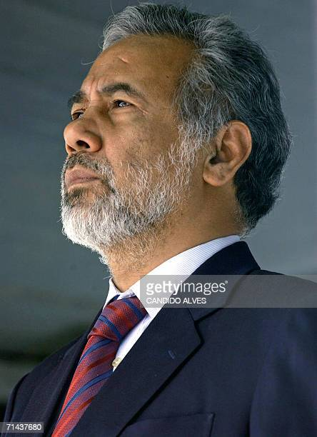East Timorese President Xanana Gusmao listens to national anthem during a sworn in ceremony of the new cabinet in Dili 14 July 2006 Gusmao swore in a...