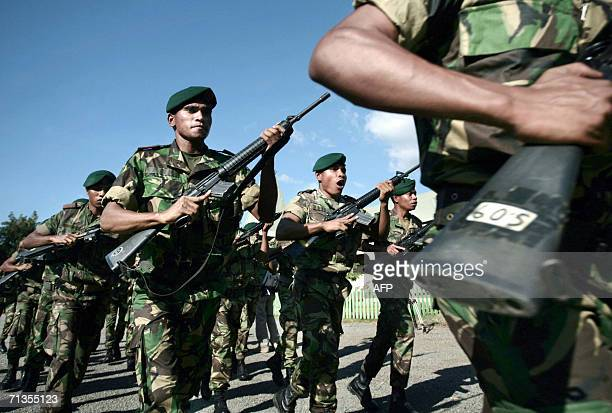 East Timorese soldiers march during a ceremony before President Xanana Gusmao delivered a speech to the soldiers in Dili 03 July 2006 The man widely...