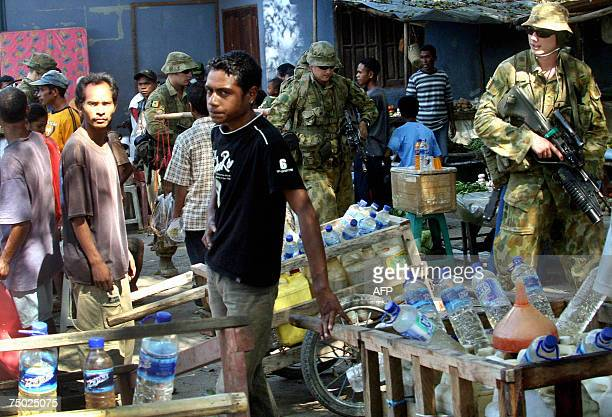 International peacekeeping soldiers from Australia patrol a market area in Dili 04 July 2007 East Timor appeared headed for a coalition government...
