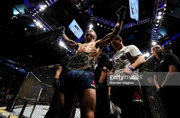 Dillashaw celebrates his knockout victory over Cody Garbrandt in their UFC bantamweight championship bout during the UFC 217 event inside Madison...