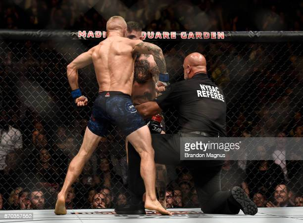 TJ Dillashaw celebrates his knockout victory over Cody Garbrandt in their UFC bantamweight championship bout during the UFC 217 event inside Madison...