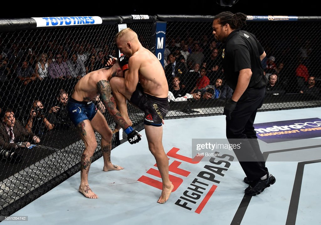 TJ Dillashaw knees Cody Garbrandt in their UFC bantamweight championship fight during the UFC 227 event inside Staples Center on August 4, 2018 in Los Angeles, California.