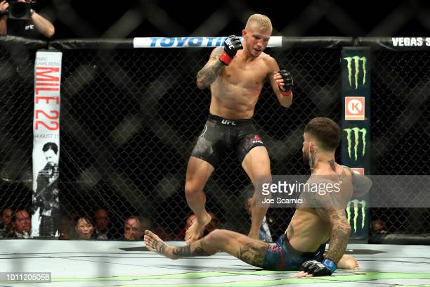 Dillashaw knocks down Cody Garbrandt in the first round of the UFC Bantamweight Title Bout during UFC 227 at Staples Center on August 4 2018 in Los...