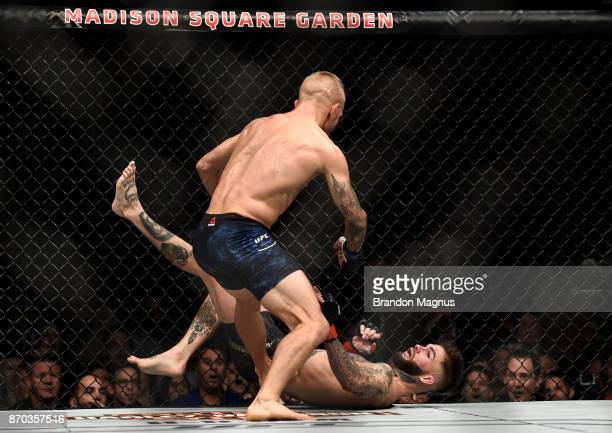 TJ Dillashaw knocks down Cody Garbrandt in their UFC bantamweight championship bout during the UFC 217 event inside Madison Square Garden on November...