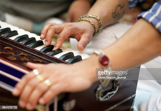 Dilli Subedi practices harmonium during class at the Himalayan Music Academy on Saturday April 8 in Akron Ohio